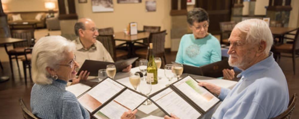 Residents eating dinner together at The Springs at Tanasbourne in Hillsboro, Oregon