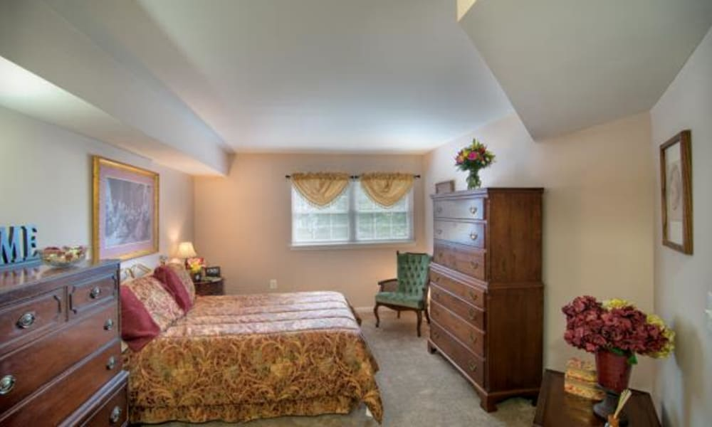 A furnished apartment bedroom at Chancellor's Village in Fredericksburg, Virginia