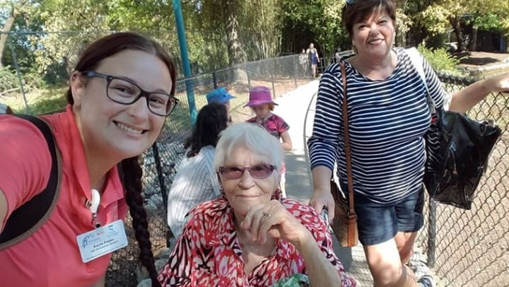 Joyce, her daughter, Carol, and Life Enrichment Director, Kayla, posing for a selfie at Kentucky Kingdom