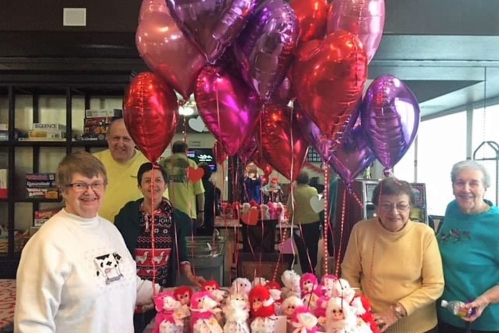 Senior residents at a party with balloons