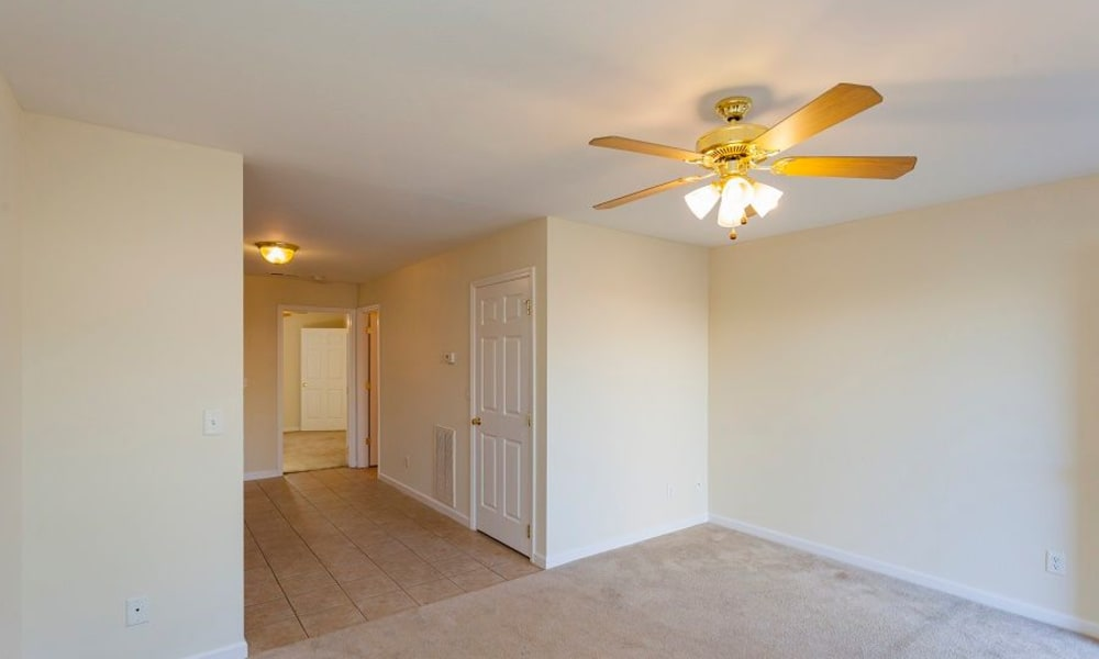 Living room with ceiling fan at Home Place Apartments in Chattanooga, Tennessee