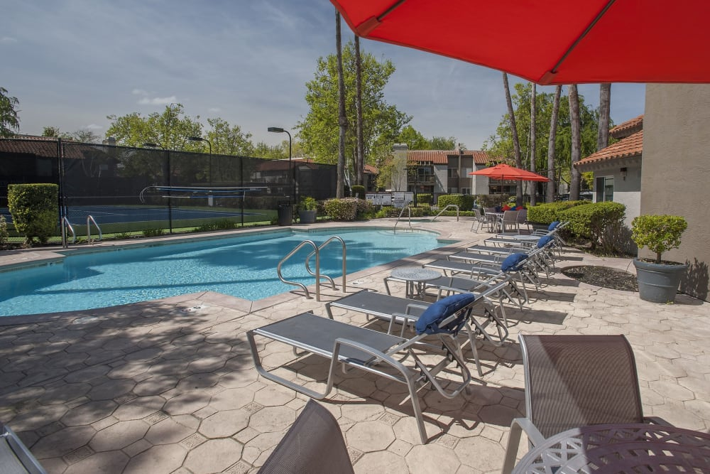 Spacious sundeck with lounge chairs next to a swimming pool at Shore Park at Riverlake in Sacramento, California