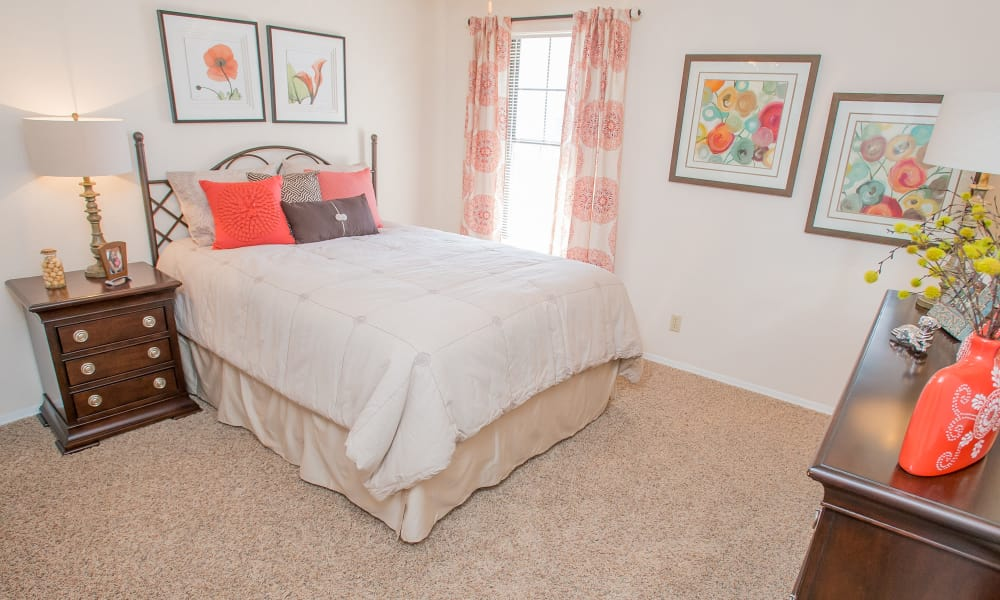 Well-decorated bedroom at Barrington Apartments in Tulsa, Oklahoma