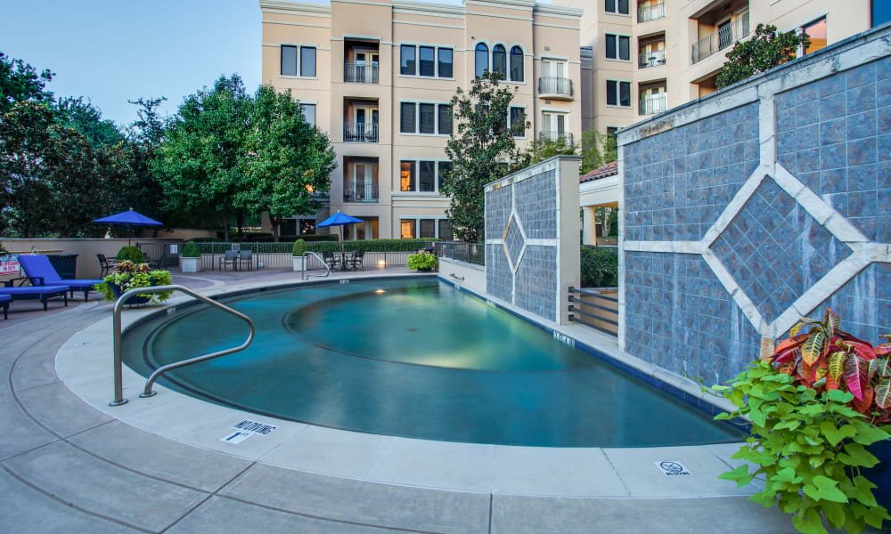 Sparkling pool at Rienzi at Turtle Creek Apartments in Dallas, Texas