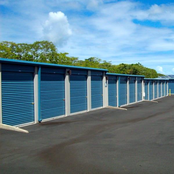 Outdoor storage units with blue doors at StorQuest Self Storage in Kea'au, Hawaii