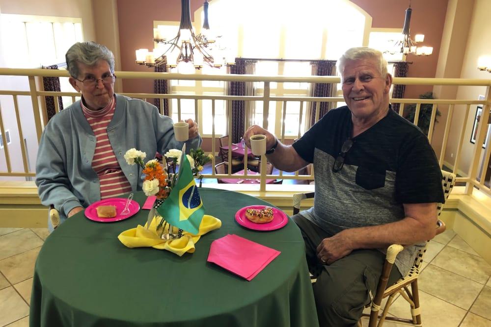 Residents enjoying Brazilian coffee at The Oaks, A Merrill Gardens Community in Gilbert, Arizona.
