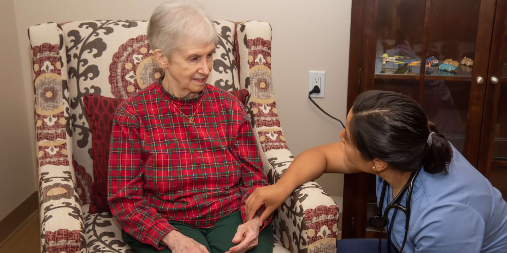 A nurse taking a patient's pulse at Careage Home Health in Bellevue, Washington.