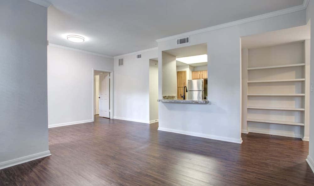 Hardwood floors in the open-concept layout of a model home at Riata Austin in Austin, Texas