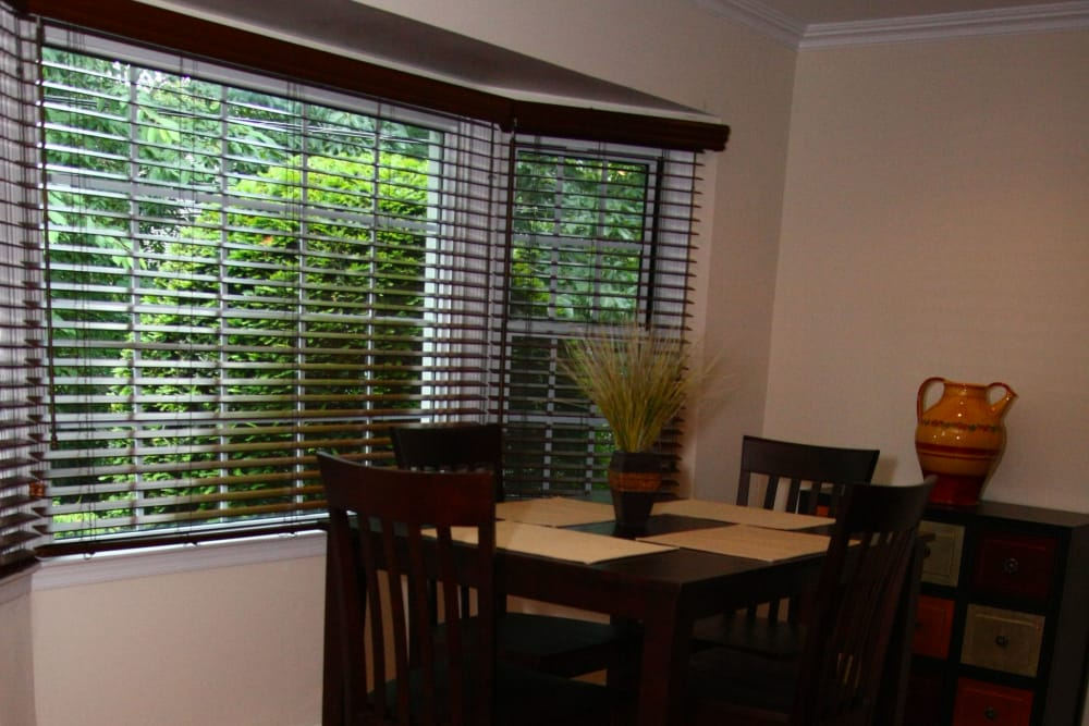A large bay window provides lots of natural light in the dining area at Brandywyne at Brielle