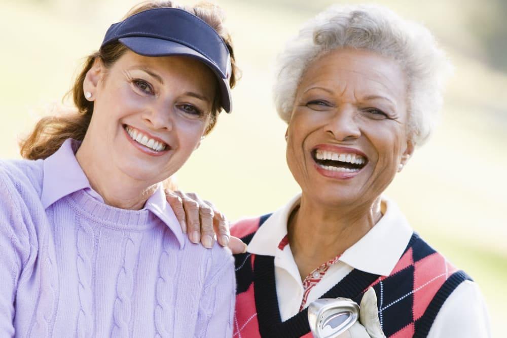 Women out golfing near Liberty Square