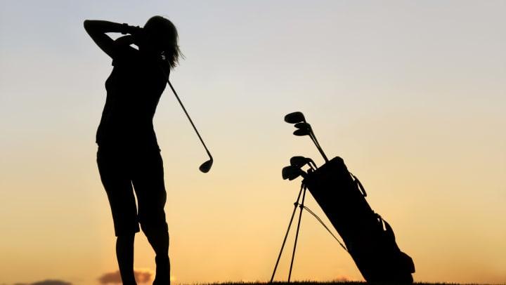 Woman golfing near Olympus Woodbridge in Sachse, Texas