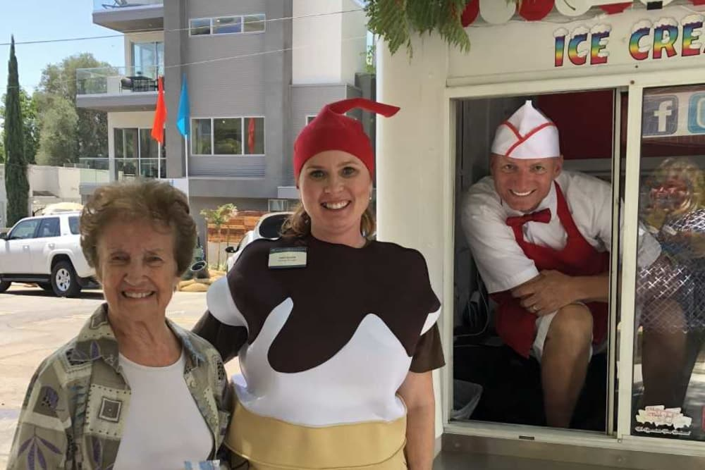 General Manager and resident enjoying ice cream together at our senior living community in San Diego, CA
