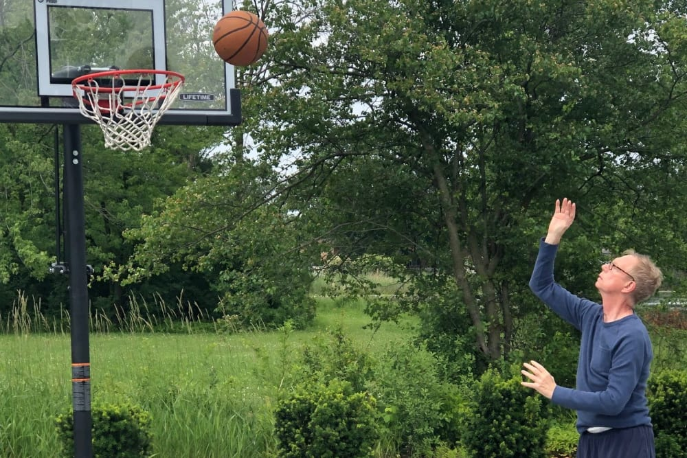 senior resident playing basketball