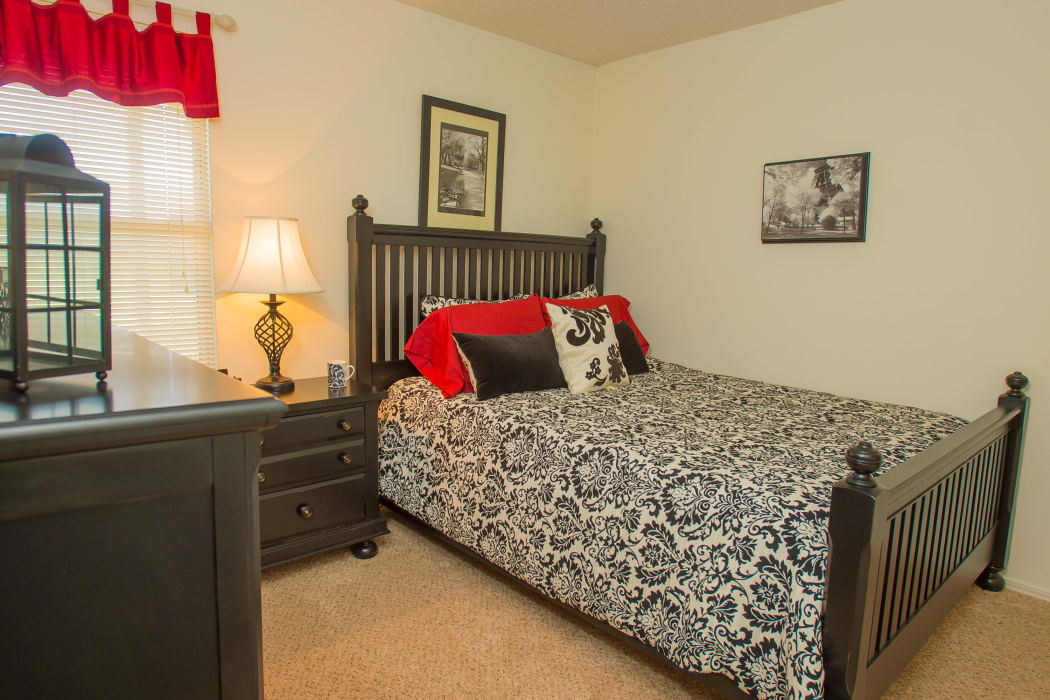 Comfortable bedroom at Riverpark Apartments in Tulsa, Oklahoma