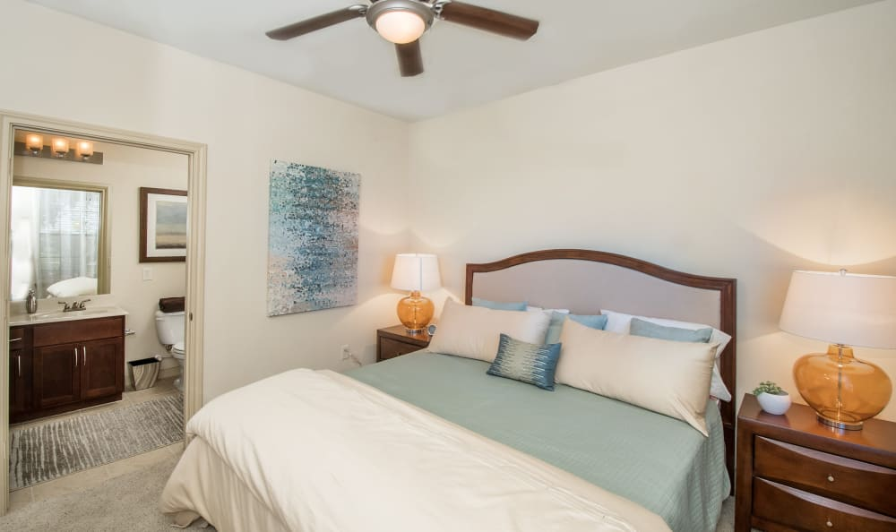 Bedroom with ceiling fan and plush carpeting at Villas Tech Ridge in Pflugerville, Texas
