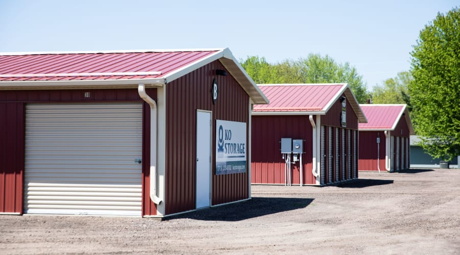 Red storage buildings with white doors at KO Storage of Black River Falls in Black River Falls, Wisconsin