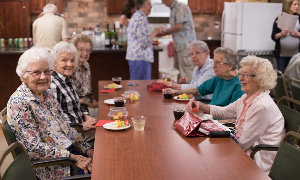 A group of residents having drinks together at The Keystones of Cedar Rapids in Cedar Rapids, Iowa