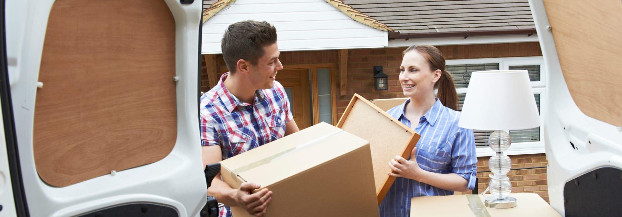 Couple moving boxes to Self Storage Plus in Manassas, Virginia