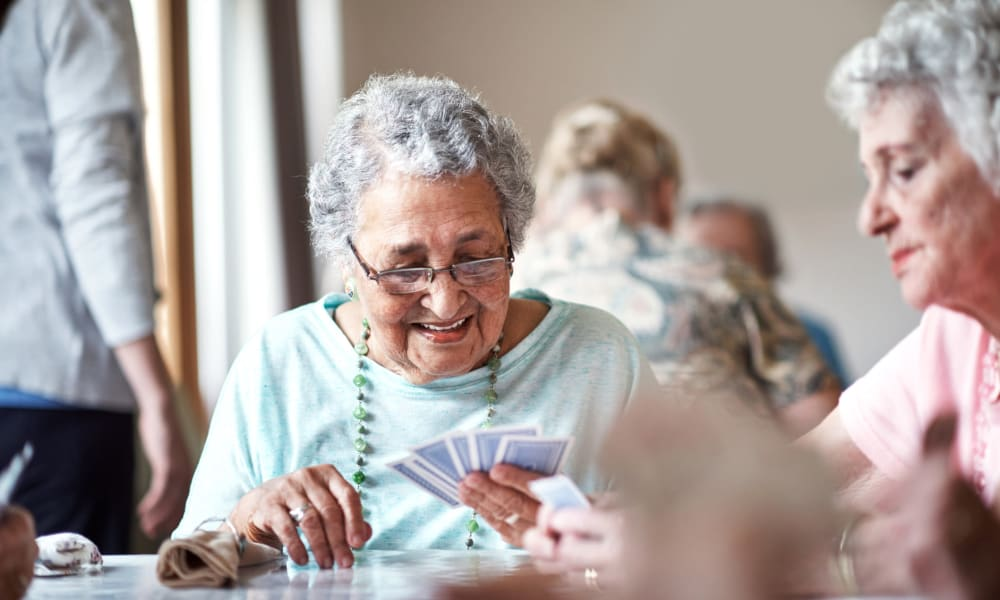Residents playing cards in the game room at Villa at the Lake in Conneaut, Ohio
