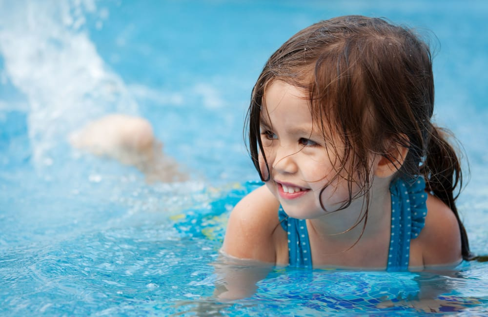 A child playing in the pool at Parktowne Apartments in Cleveland, Tennessee