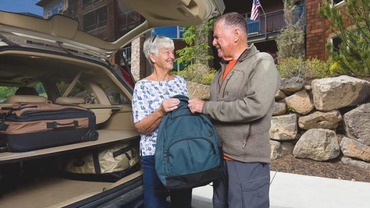 Fran and Ralph Brown packing their car