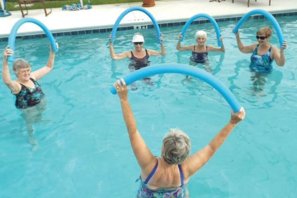 A group of residents in the pool at Cypress Springs Gracious Retirement Living in Bradenton, Florida