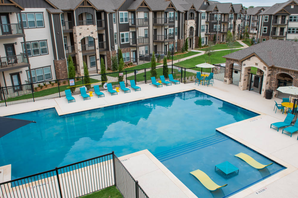 Outdoor resort-style pool at Bend at New Road Apartments in Waco, Texas