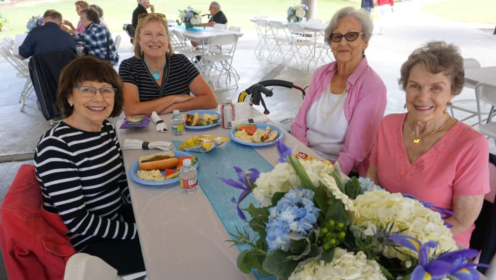 Merrill Gardens residents enjoying a picnic together in Kirkland, WA
