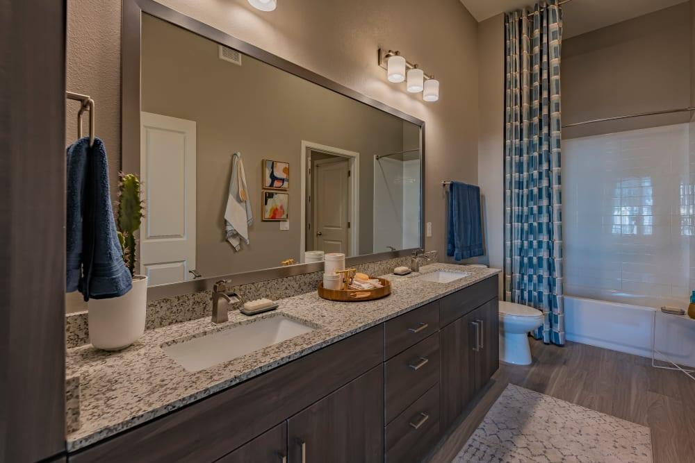 Bathroom with wood-style flooring at The Tessera in Phoenix, Arizona