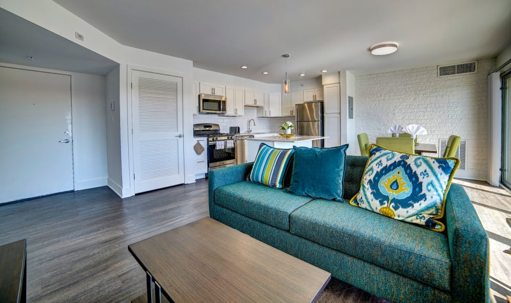 Hardwood floors and comfortable furnishings in the living area of a model home at Watergate Pointe in Annapolis, Maryland