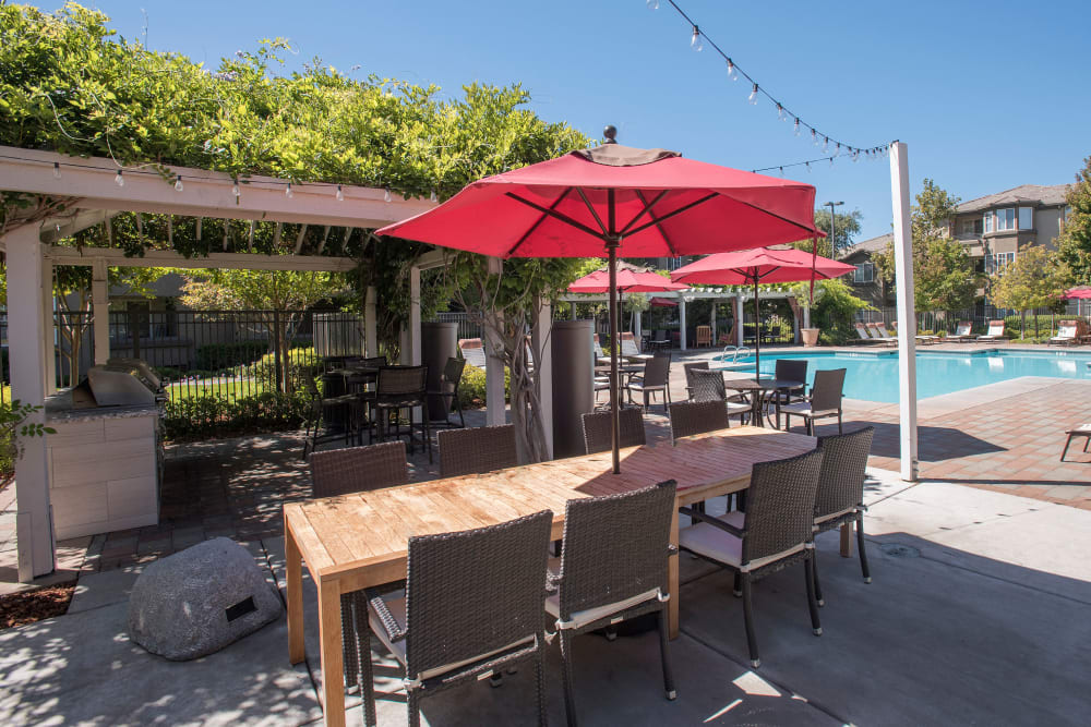 Gazebo with barbecues and tables for entertaining guests at The Artisan Apartment Homes in Sacramento, California