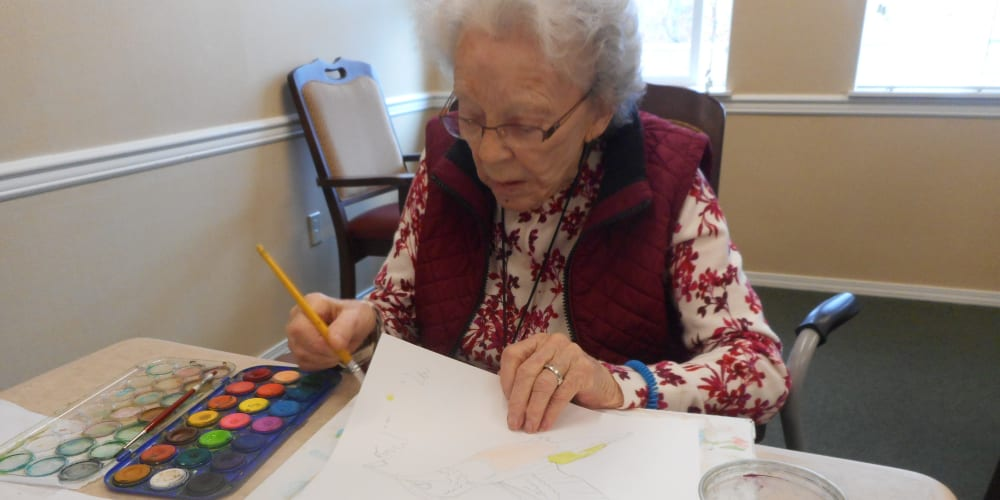 A resident making an art project at Patriots Glen in Bellevue, Washington.
