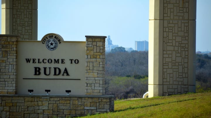 Monument sign welcoming all to our city near Carrington Oaks in Buda, Texas