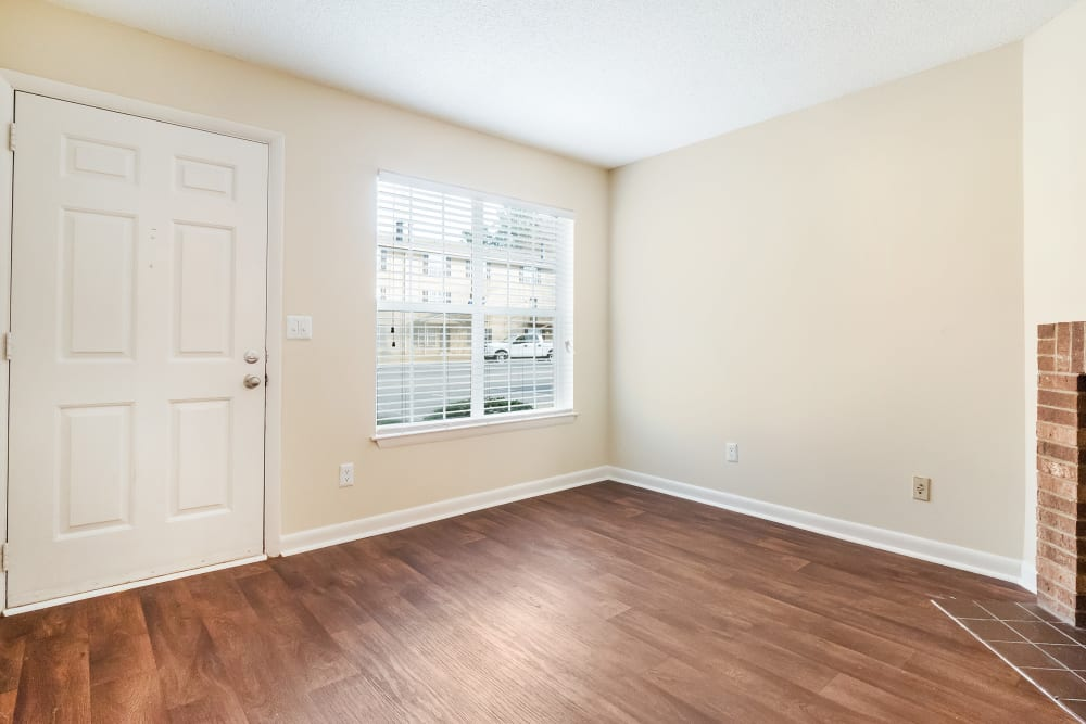 Spacious room with hard wood style flooring at The Hills at Oakwood in Chattanooga, Tennessee