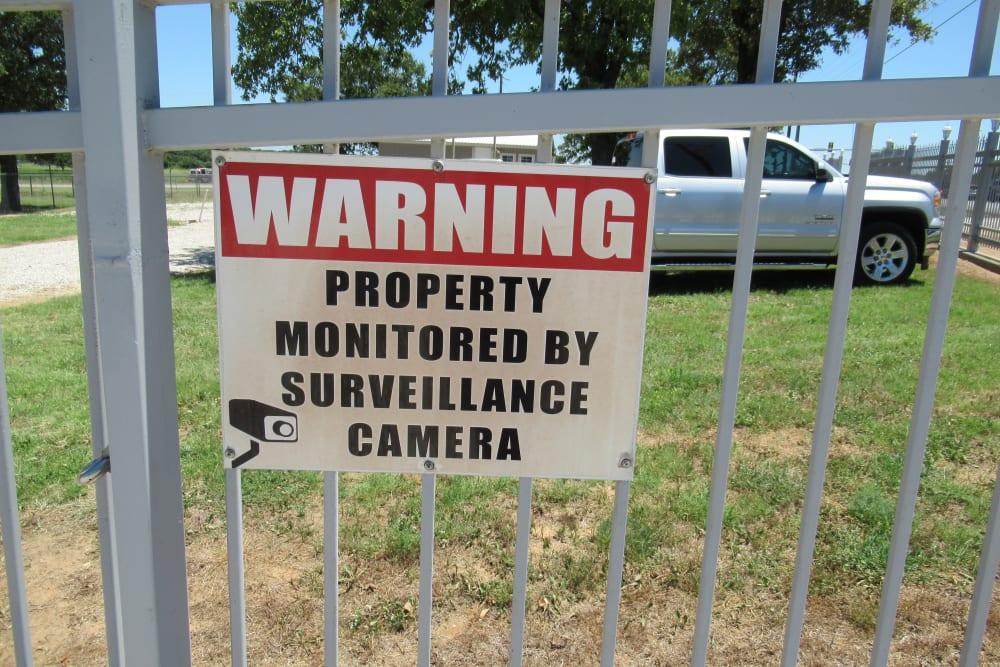 Warning property monitored by surveillance camera sign at Springtown Self Storage