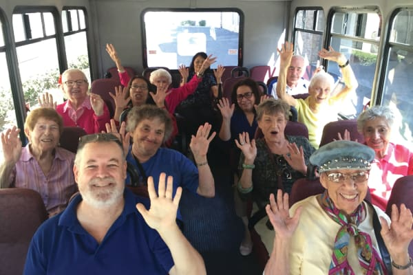Happy residents on the bus to go shopping with Camden Springs Gracious Retirement Living in Elk Grove, California