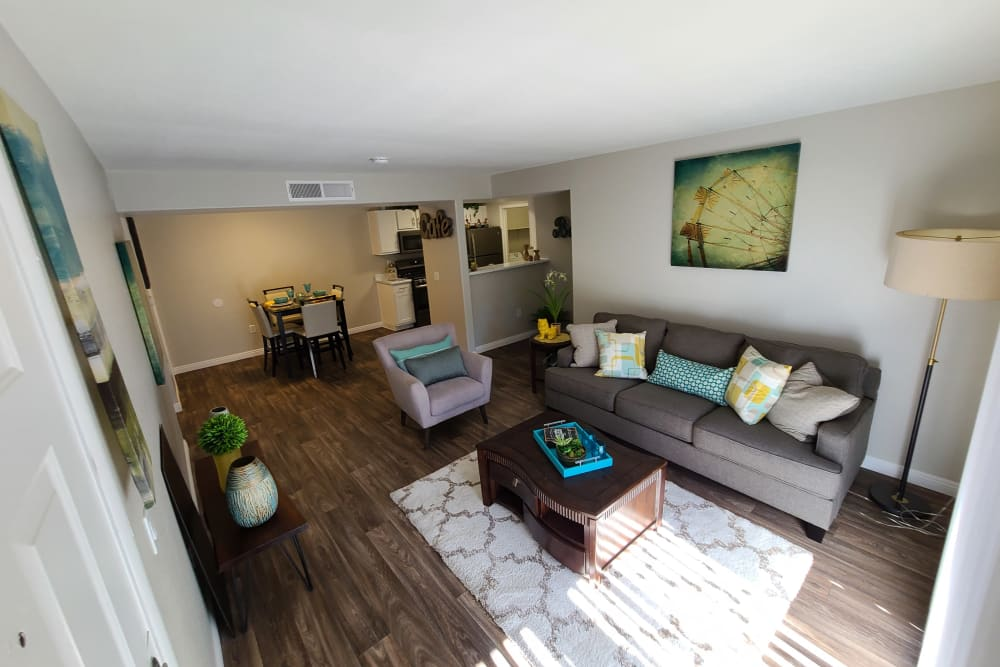 Well-furnished model home's living area with wood-styling at Alterra Apartments in Las Vegas, Nevada