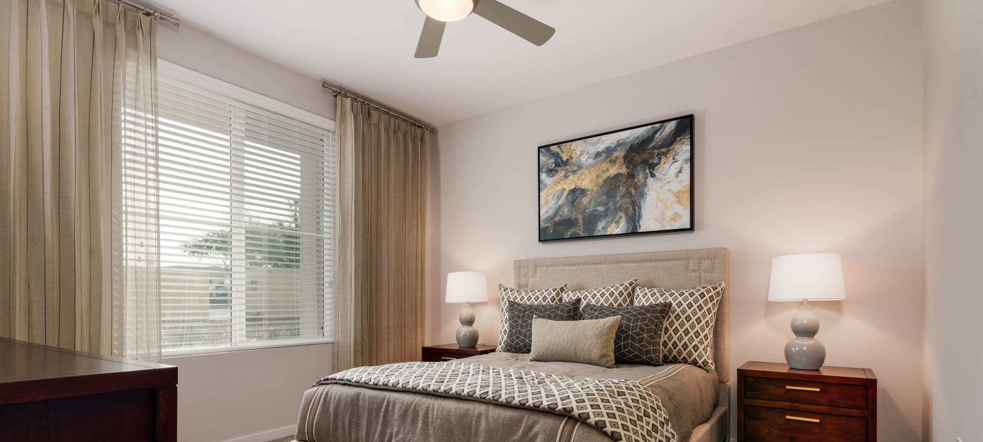 Spacious bedroom with a ceiling fan and large window at Morrison Chandler in Chandler, Arizona