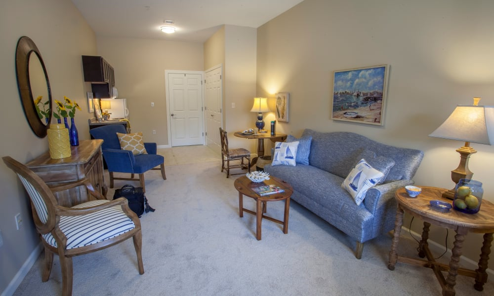 A decorated apartment living room and kitchen at Keystone Place at  Buzzards Bay in Buzzards Bay, Massachusetts