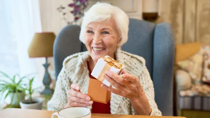 Senior woman opening present
