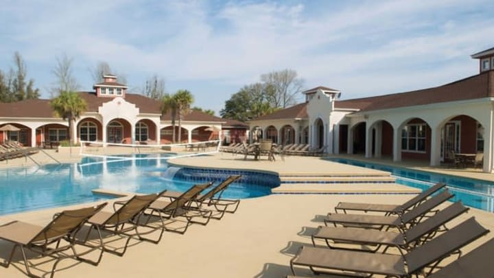 Pool Deck Area at Blanton Common Student Apartments in Valdosta, GA