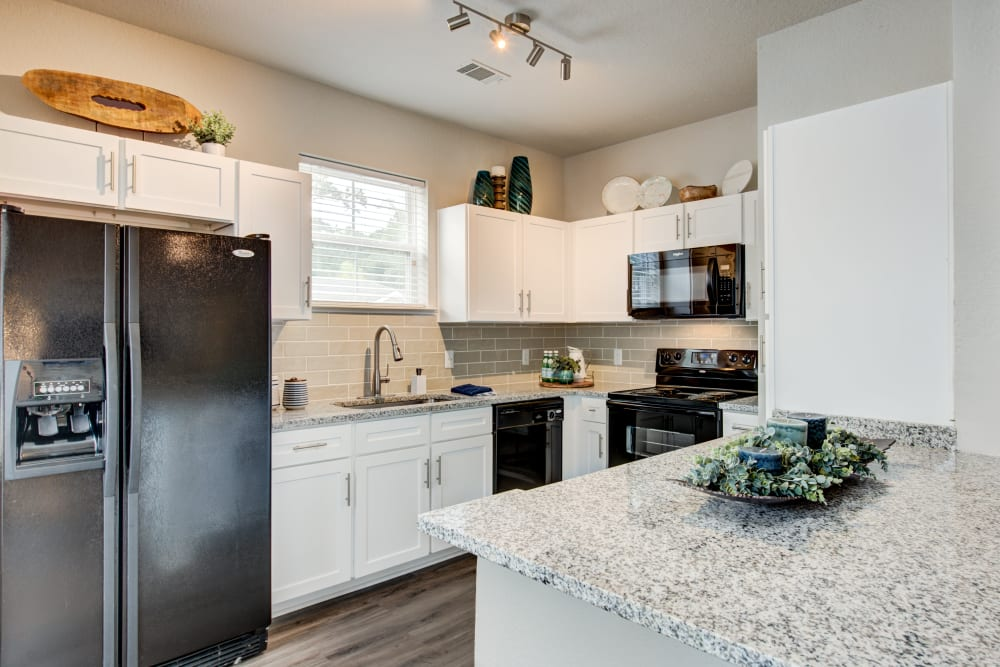Beautiful kitchen featuring modern appliances and amenities  at Ingleside Apartments in North Charleston, South Carolina