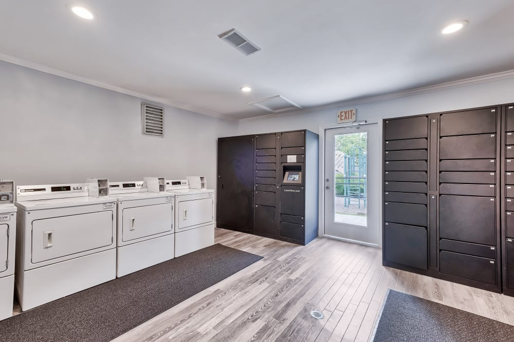 Package Lockers & Laundry Facility at Woods of Williamsburg Apartments in Williamsburg, Virginia