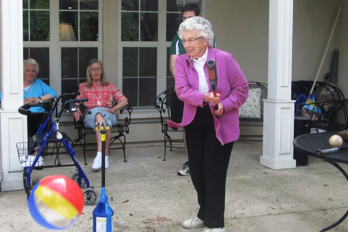 Residents playing games at Parsons House Preston Hollow in Dallas, Texas