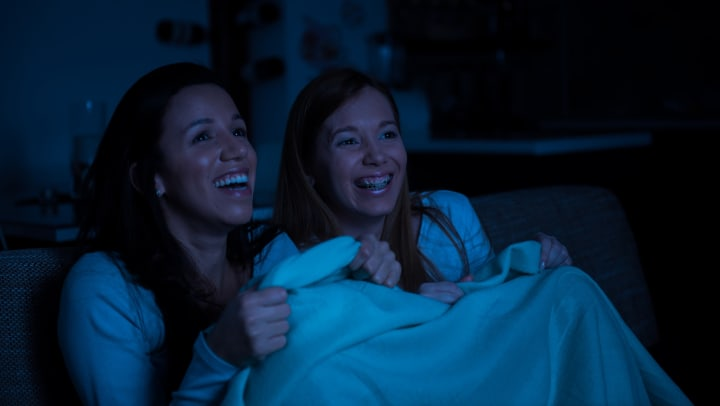 Mother and daughter watching a movie together