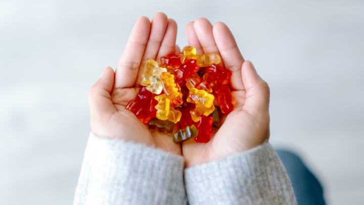 Hands holding gummy bears at The Davis in Fort Worth, Texas