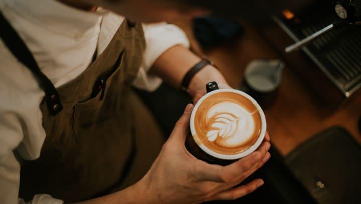 Latte with foam art in barista