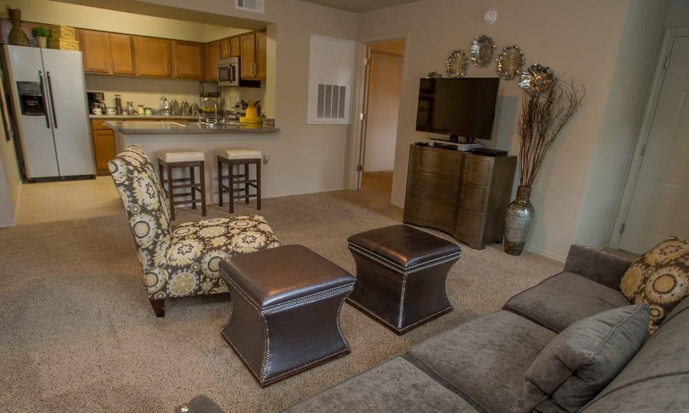 Living room with a view of the kitchen at Tuscana Bay Apartments in Corpus Christi, Texas