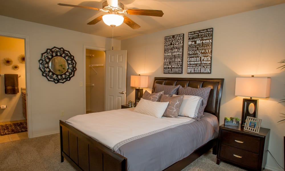 Primary bedroom with a ceiling fan at Tuscana Bay Apartments in Corpus Christi, Texas