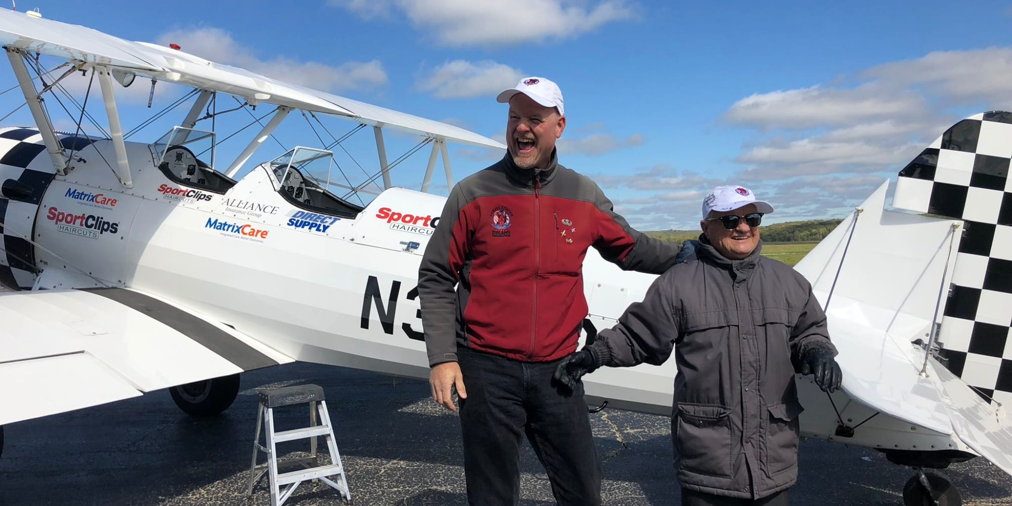 Resident from Camden Springs Gracious Retirement Living in Elk Grove, California, in front of a plane